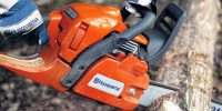 Husqvarna-450-best-firewood-chainsaw-cutting-log